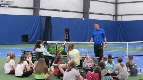 Rick Witsken Teaching a Tennis Program